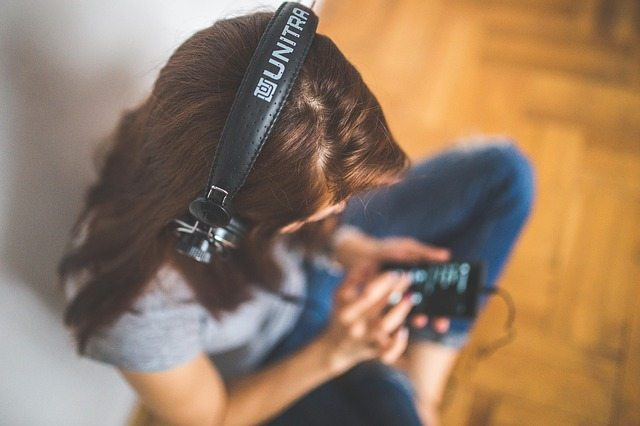 best way to learn a language listen to music
